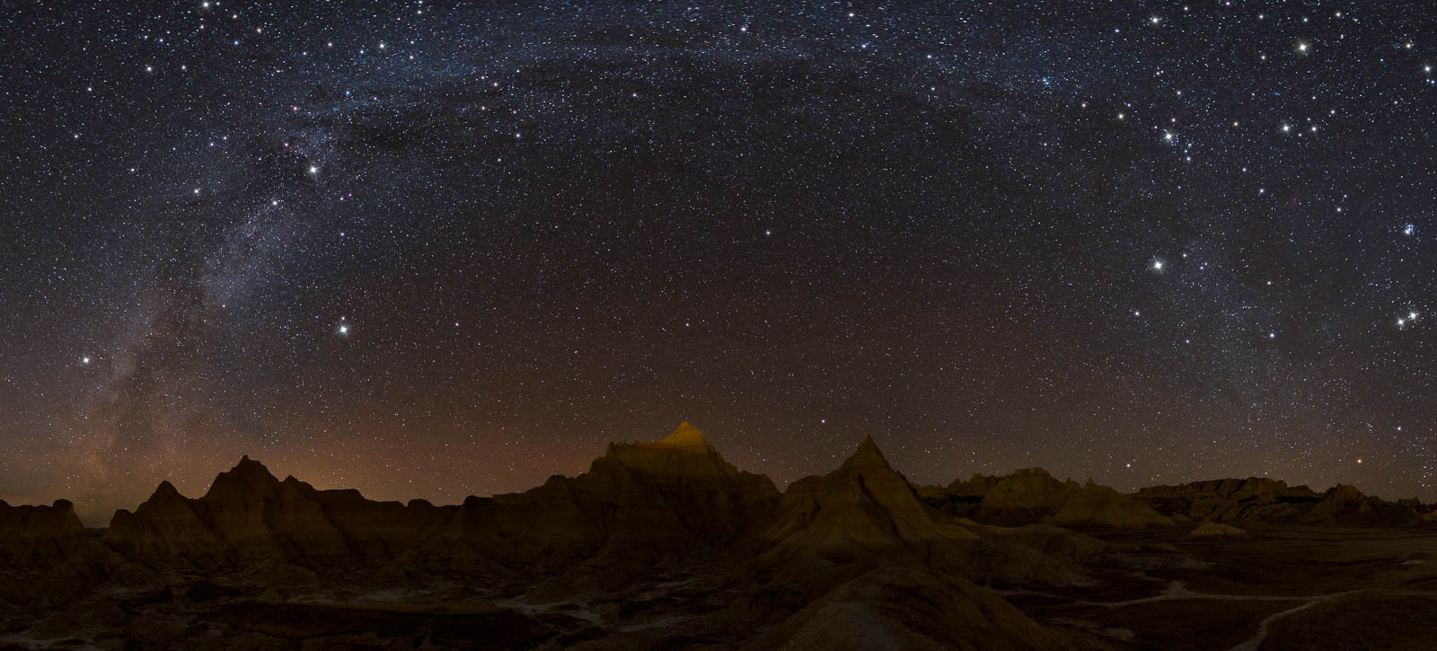 Who says you can't shoot the milky way in the winter? Taken a week ago in the Badlands in South Dakota. This is a 13 image pano...